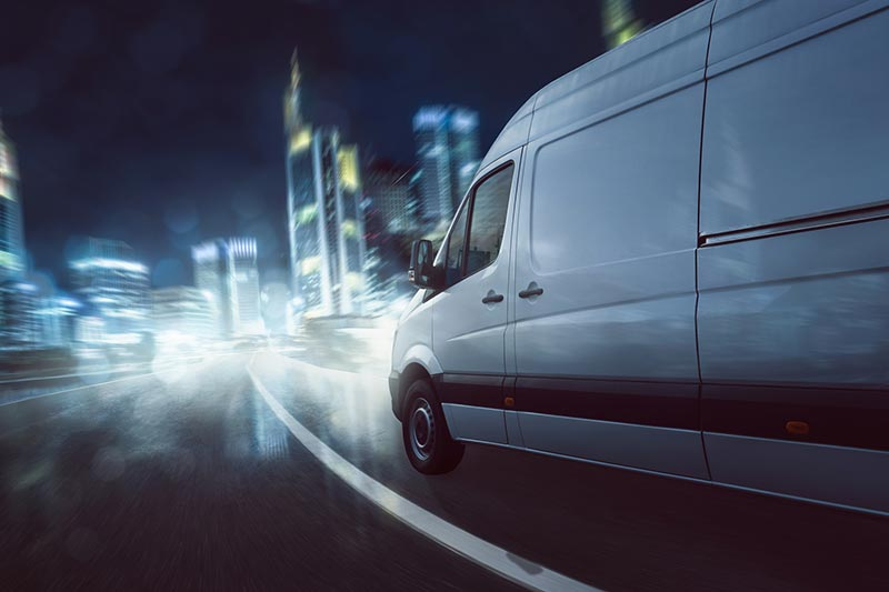 Courier driving at night